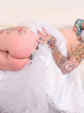Busty Tattooed Bride Strips