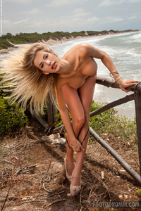 Claudia Busty Blone Posing On Beach