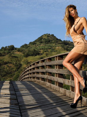 Claudia Busty Babe With Amazing Body Strips On The Bridge