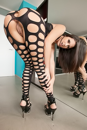 Carolina Abril Poses In Fishnet Bodystocking