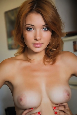 Beautiful Red-haired Girl Posing Nude In The Kitchen