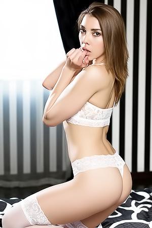Ukrainian Model Daniela Posing In White Lingerie