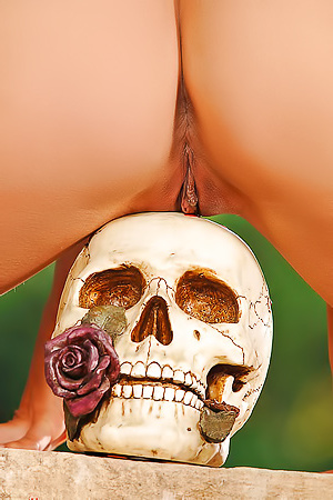 Vixen Eve Angel Playing With A Skull And A Knife