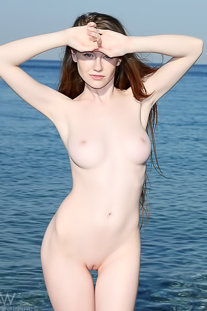 Sexy beach bunny strips naked here