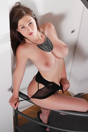Hot Brunette Pulls Down Her Black Tight Dress On Stairs