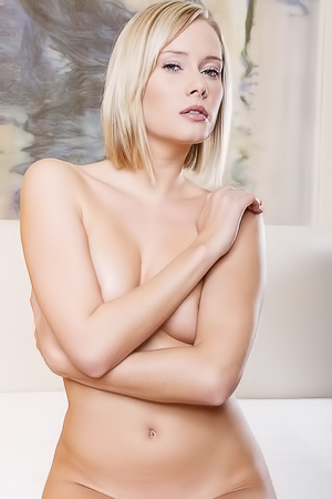 Denise Poses Nude On A Bed