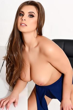 Sarah Teasing At The Desk In Her Blue Bodysuit