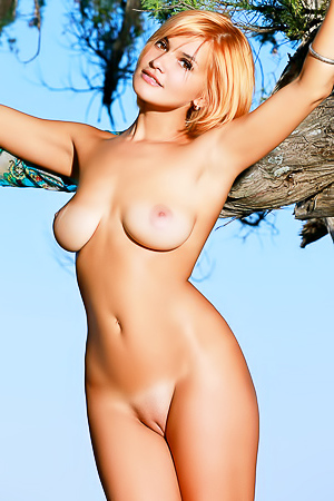 Busty Redhead Dina Gets Nude Outdoors