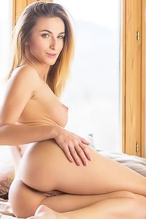 Cara Mell Strips Off And Poses Naked On The Bed