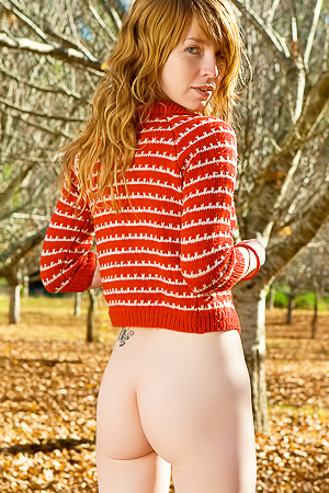 Ginger chick goes for a naked walk in autumn forest.