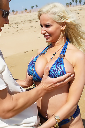 Busty Milf Holly Brooks Strips On The Beach