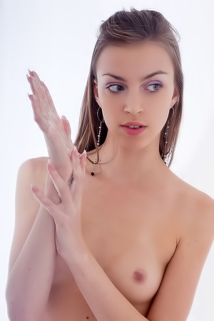 Totally naked chick rubs pussy in bathroom.