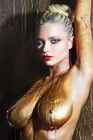 Covered in gold a blonde is artistically naked
